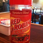Photo taken at Red Robin Gourmet Burgers by Erin M. on 10/15/2012
