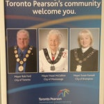 Take a photo of 'esteemed' Toronto Mayor Rob Ford greeting travelers on one of his chirpier photos in happier days  - just after you exit Customs.