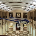 Aviation museum and library is super quiet, has loads of outlets for electricity, and is totally deserted. Check it out! Next to G91-G102 security check point