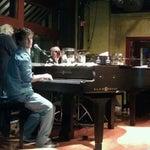 Photo taken at Mojo's Dueling Piano Bar by Lori on 3/2/2012