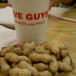 Photo taken at Five Guys by Emmy K. on 12/5/2011