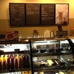 Photo taken at Starbucks by Arda K. on 8/10/2012