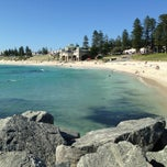 Photo taken at Cottesloe Beach by Geoff K. on 3/28/2013