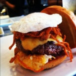 Photo taken at Umami Burger by Rick N. on 10/17/2012