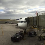 Photo taken at Gate 30 by Adrian L. on 12/15/2014