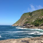 Photo taken at Praia de Itacoatiara by Tamara A. on 3/3/2013