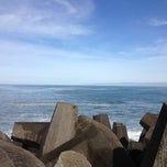 Photo taken at North Jetty by Kim J. on 11/23/2012