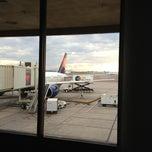 Photo taken at Gate 23 by Peggy G. on 7/14/2013