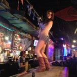 Photo taken at Coyote Ugly Saloon by Jenn F. on 1/26/2013