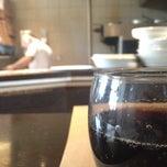 Photo taken at Momento Café by Herve K. on 3/20/2014