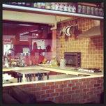 Photo taken at ESCAPE Bistro & Café by Sutin S. on 1/9/2013