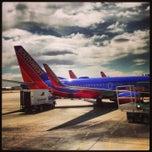 Photo taken at Albuquerque International Sunport (ABQ) by Angel L. on 5/14/2013