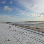 Photo taken at Road K Beach by Daron W. on 12/30/2012