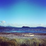 Photo taken at Petone Beach by Elishevah M. on 4/4/2013
