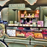 Photo taken at Ladurée by Masha C. on 6/10/2013