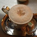 Photo taken at Grand Café de Genève by Ema e. on 10/16/2012