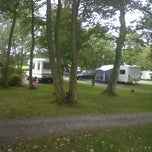 Photo taken at Ravenglass Camping and Caravanning Club by Catherine S. on 9/9/2011