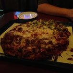 Photo taken at Red's Savoy Pizza by Ryan S. on 8/7/2013