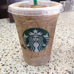 Photo taken at Starbucks by Laura T. on 5/3/2014