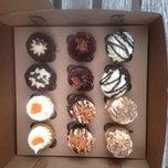 Photo taken at Indulgence Cupcakery by Patrick C. on 2/22/2013