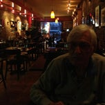 Photo taken at Swizz Restaurant & Wine Bar by betty l. on 4/9/2013