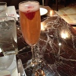 Photo taken at Grand Lux Café by Emily on 12/1/2012