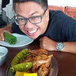 Photo taken at Ayam Goreng Nikmat (Panaitan) by Ketut s. on 2/10/2015