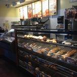 Photo taken at Einstein Bros Bagels by Juana G. on 10/6/2012