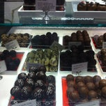 Photo taken at Godiva Chocolatier by Heather B. on 12/29/2012