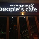 Photo taken at People's Cafe by Andrew V. on 12/25/2012