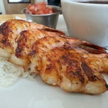 Photo taken at Blue Fish Grill by John on 5/15/2013