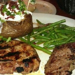 Photo taken at Tahoe Joe's Famous Steakhouse by Susan L. on 5/14/2012