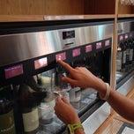 Photo taken at Loki Wine Merchant & Tasting House by Tom U. on 7/27/2013