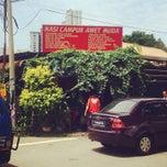 Photo taken at Nasi Campur Awet Muda by Fiqry S. on 6/14/2014