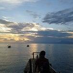 Photo taken at Pantai Senggigi by Chooey C. on 3/16/2013