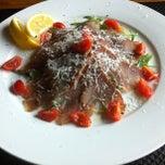 Photo taken at Tarpon Restaurant Night Bar by Marvino B. on 4/3/2013