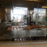 Photo taken at Krispy Kreme by Anitha N. on 12/4/2011