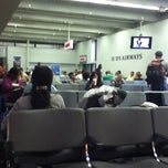 Photo taken at Gate B10 by Tarik S. on 8/5/2011