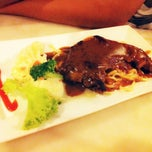 Photo taken at Umi's  Steak & Cafe by Fatimah A. on 11/29/2013