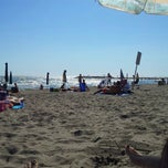 Photo taken at Spiaggia (Isola Verde) by Carlo R. on 8/16/2013