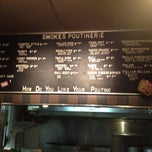 Photo taken at Smoke's Poutinerie by Katie F. on 12/21/2012
