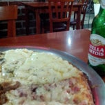 Photo taken at Pizzaria & Restaurante Dom Marco by Mika M. on 3/31/2014