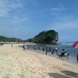 Photo taken at Pantai Indrayanti by Ari R. on 1/1/2013