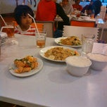 Photo taken at D'Cost Seafood by Wahyudi T. on 4/9/2014