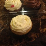 Photo taken at Kitsch cupcakes by Kendra O. on 10/31/2014