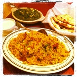 Photo taken at Saffron Indian Cuisine by Craig L. on 2/10/2012