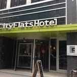 Photo taken at CityFlats Hotel by Tiffany J. on 8/2/2013