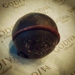 Photo taken at Godiva Chocolatier by Dmitry C. on 9/18/2014