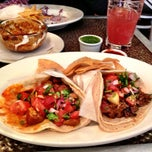 Photo taken at La Taqueria De Los Muertos by Christen D. on 12/5/2012