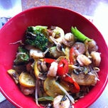 Photo taken at Genghis Grill by Angie C. on 6/13/2012